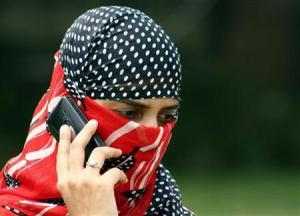 A girl speaks on a mobile phone in Jammu